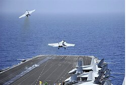 F/A-18F Super Hornets launch from US Navy aircraft carrier USS Enterprise