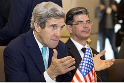 John Kerry gestures during meeting in Algiers