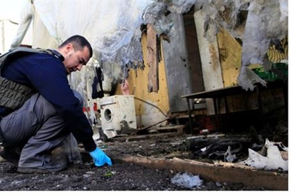 Examining mortar damage in Sha'ar HaNegev (archive)