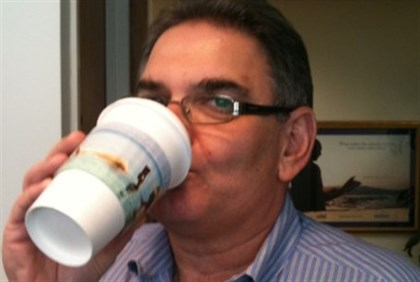 Israel Tourism Commissioner Chaim Gutin with Dead Sea coffee sleeve