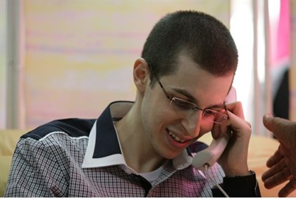 Shalit on phone with family.