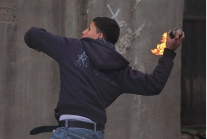 Arab youth throws firebomb