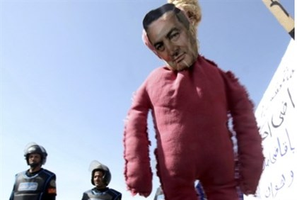 A protesters' effigy of Hosni Mubarak hangs outside courtroom