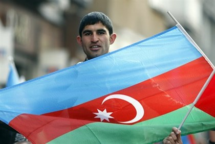 Man holds Azerbaijani flag