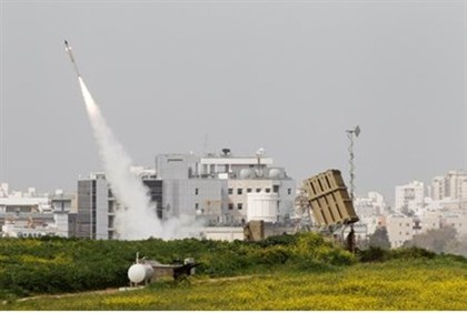 An Iron Dome launcher fires an interceptor rocket