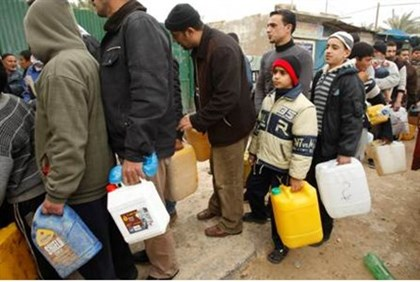 Gaza Arabs line up with fuel containers.