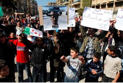 Lebanese and Syrian protesters shout slogans against Assad