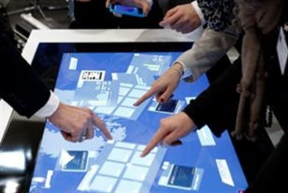 Touch screens at booth of Microsoft at computer fair