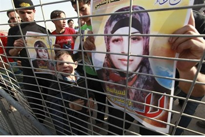 Arabs hold posters of Hana Shalbi