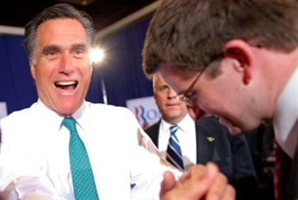 Romney greets audience during a campaign stop in Rhode Island April  11