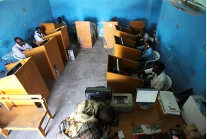 People surf the Internet at a cyber cafe in Somalia