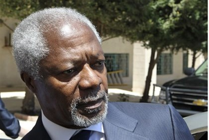 U.N.-Arab League envoy Kofi Annan enters his car after his meeting with Jordan's Foreign Minister Na