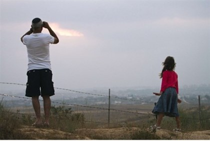 Israelis watch rocket launches from Gaza.