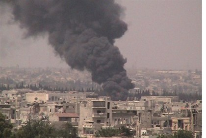 Smoke rises from Baba Amr, Homs