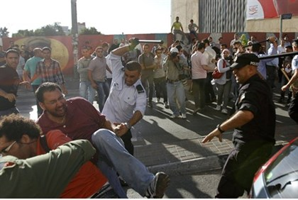 Members of the PA security forces beat demonstrators in Ramallah July 1, 2012
