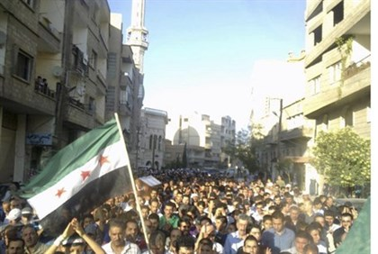 Opposition funeral in Damascus for boy killed by gov't forces