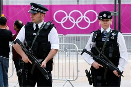British police officers patrol outside the London 2012 Olympic Park
