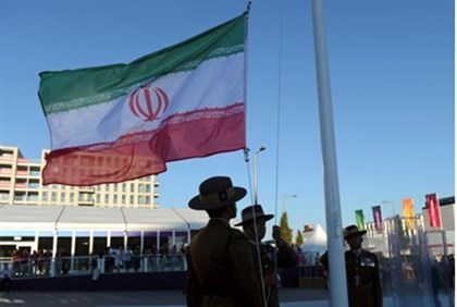 British Army soldiers raise the flag of the Islamic Republic of Iran at the Olympic Villag