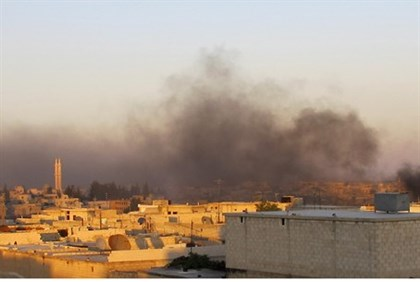 Smoke rises after government forces fire mortar in Azzaz, Aleppo province July 17, 2012.