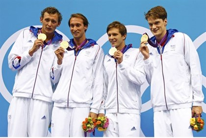 France's Amary Leveaux, Fabien Gilot, Clement Lefert and Yannick Agnel (L-R) pose with their gold me