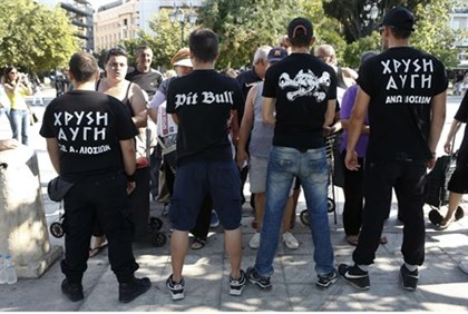 Supporters of Greece's Golden Dawn extreme right party secure an area where fellow party supporters