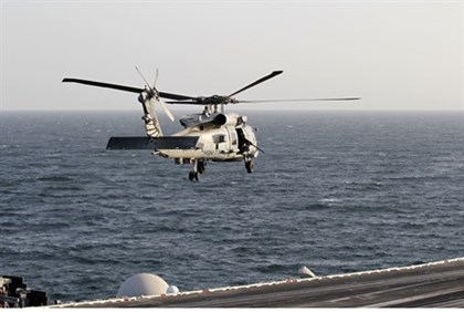 in Strait of HormuzA helicopter from Nimitz-class aircraft carrier USS Abraham Lincoln