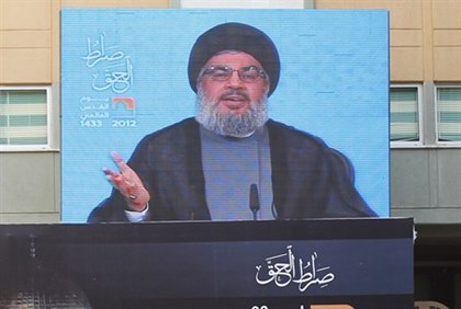Hizbullah leader Nasrallah addresses his supporters via a screen
