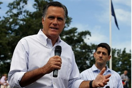 Mitt Romney (L) and vice-presidential candidate, U.S. Representative Paul Ryan (R-WI)