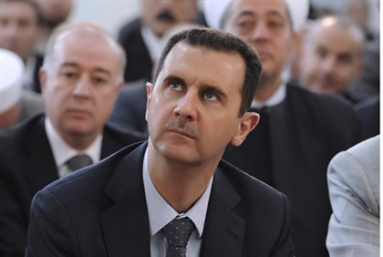 Assad attends Eid Al Fitr prayers