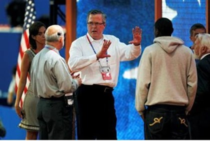 Former Florida Governor Jeb Bush (C) tours the stage after the opening session of the Republican Nat