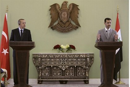 File photo of Assad and Erdogan at a news conference