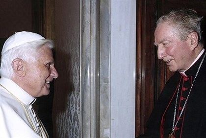 File photo of Pope Benedict XVI shaking hands with Italian Cardinal Maria Martini at the Vatican
