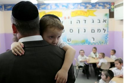 Boy being comforted by teacher