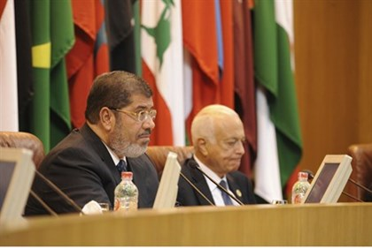 Morsi talks at the Arab League headquarters in Cairo