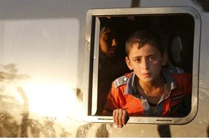 Young Syrian refugee on his way to Turkey