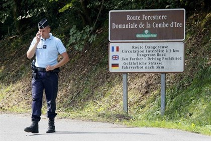 French gendarmes block access to a road to La Combe d'Ire in Chevaline near Annecy, southeastern Fra