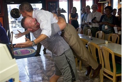 Pizza parlor owner Van Duzer got an online beating from opponents to Obama