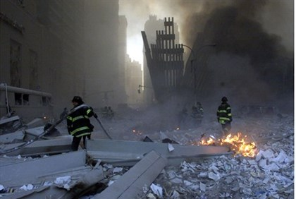 File picture shows firemen working around the World Trade Center after both towers collapsed in New