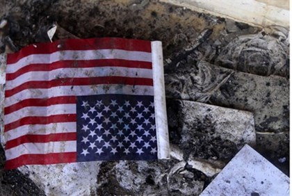 Flag among debris in U.S. consulate.