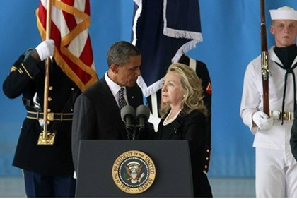 U.S. President Obama and Secretary of State Clinton deliver remarks during a transfer ceremony of th