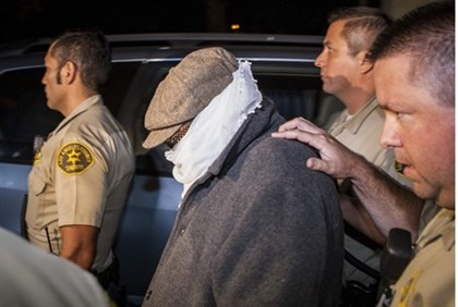Nakoula Basseley Nakoula is escorted out of his home by Los Angeles County Sheriff's officers in Cer