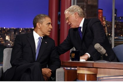 Seated with talk show host David Letterman, U.S. President Barack Obama makes an appearance on the ""