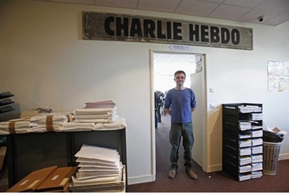 French satirical weekly Charlie Hebdo publishing director Charb poses at their offices in Paris