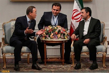Ban Ki-moon (L) speaks with Ahmadinejad  at Non Alligned Movement conference