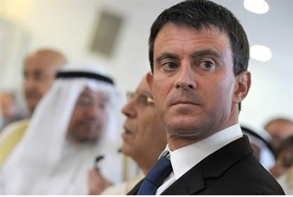 France's Interior Minister Valls stands on a balcony during the official inauguration of the Grand M