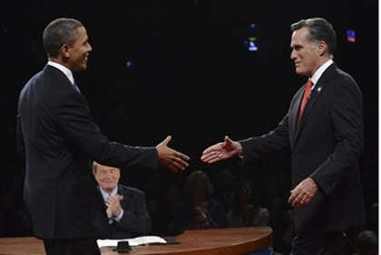 Republican presidential nominee Mitt Romney shakes hands with President Barack Obama at the start of