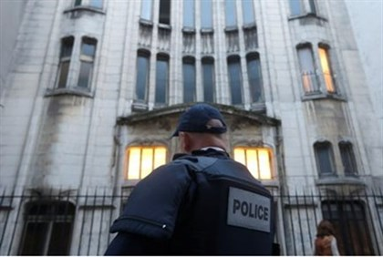 A French police officer secures the main entrance of a synagogue in Paris,