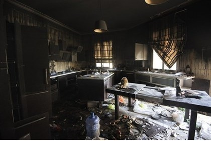Damage inside the burnt consulate building in Benghazi