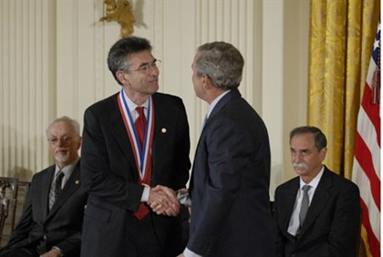 Handout photo of Lefkowitz being congratulated by then U.S. President Bush after receiving the Natio
