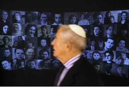 A visitor looks at an exhibition at the holocaust museum in newly opened Jewish Menorah Center in Dn